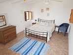 Bedroom 5 (kingsize) with private terrace, separate to house, nearest toilet/shower in main house.