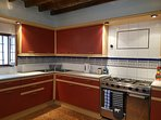 Kitchen with gas hob, oven, fridge/freezer, dishwasher, kettle, toaster, well equipped.