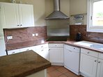 Kitchen with fridge/freezer, oven, microwave, dishwasher, double sink, induction hob