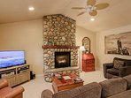 Lovely stone fireplace, large screen TV and free WiFi