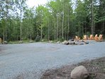 Fire pit, picnic area, and large parking area behind the home.