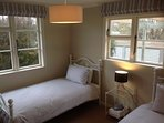 Bedroom 3: Two King Single beds.