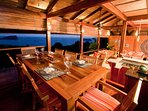 8-Seated dining area with open pacific ocean views