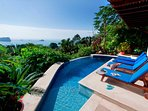 Pool sun deck with endless ocean & jungle views