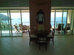 Double entrance to the terrace. Table for 6 and three lounger chairs.