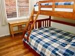 Double bed, single bunk above & single trundle bed below. Bunk & trundle suitable for children only.