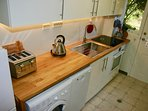 Well equipped kitchen with fridge/freezer, cooktop & oven, washer/dryer and plenty of utensils.