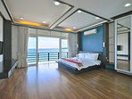 Oceanview master bedroom with big screenTV and terrace patio