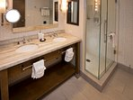 Large bathroom with rain shower and soaking tub