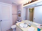 There r two lavatories and commodes srparated by a bathtub/shower.(Jack&Jill bathroom)
