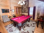 The elegant loft pool table room 'in the parlor' with tapestry and  log walls.
