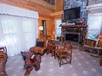 Vaulted stone fireplace, big screen TV, views of pond, doesn't get any better than this!