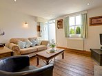 Wren Cottage snug cosy lounge with gas stove and with Laura Ashley furnishings