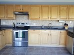 Super clean lined kitchen is open to all living and dinning areas.