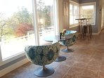 Sitting areas to watch golfers, or views.  Mid century style with comfortable attitude.