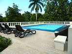 Private swimming pool also BBQ enclosed in a beautiful fruited gardens with indigenous flowers