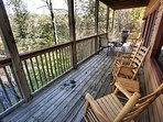 Back deck with plenty of rocking chairs and a natural gas grill.