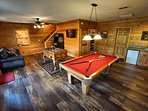 Big game room with pool table, multi-cade, foosball and a mini fridge.