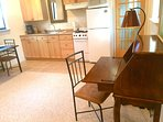Fully equipped kitchen serves up to 4 guests, with writing/laptop desk