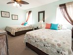 Large second bedroom with two, queen beds, closets and attached full bath.