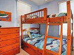 Float away into a deep sleep on this ocean-themed full-over-full bunk bed.