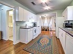 The modern kitchen is fully equipped and includes granite countertops.