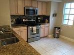 Light & Airy Upstairs Kitchen with Stainless Steel Appliances, Refrigerator, Range, Dishwasher