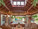 Spa wing showing elevated hot tub, stained glass window, sauna, steam shower, lounge area