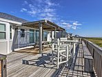 Catch refreshing ocean breezes on the private deck.