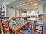 Gather around the gorgeous wood dining room table to enjoy home-cooked meals.
