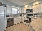 Everything needed to prepare your favorite dishes can be found in the fully equipped kitchen.