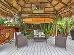 With a tiki hut next to the pool, you'll feel like you're in paradise at this wonderful beach home!