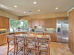 The gourmet kitchen is fully equipped with stainless steel appliances, ample granite countertops and beautiful tile...