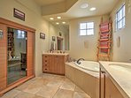 Choose between a soothing bubbling bath or a nice rinse in the walk-in shower.
