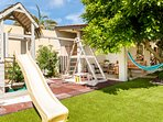 slide, swings, climbing frame, sand tray and trampoline