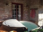 Private hot tub just outside the main bedroom french doors.