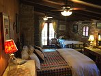 Queen bed in the main bedroom. French door leading to the hot tub.