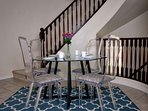 Dining table next to stairs
