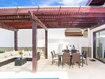 covered patio and outdoor dining at Pristine Beach Villa 104