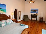 The master bedroom is expansive with king bed