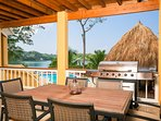 The bottom porch is open and has a palapa as well as a grill providing a great outdoor dining area.
