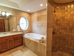Master bath with dual vanity, walk in shower and jacuzzi tub