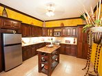 Kitchen and island well equipped for your stay