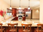 Kitchen with large breakfast bar and stools