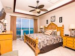 The master bedroom has a private entrance to the balcony and a King Bed
