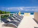 Enjoy the sun on the deck's loungers