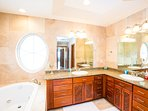 Master ensuite bathroom with double sinks and jetted tub