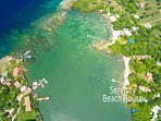 Aerial view of Mangrove Bight and Casa Etter location