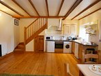 Open plan fully equipped kitchen.