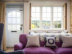 The lovely mullion window has a window seat and fabulous views